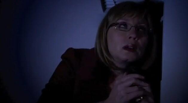 woman hiding in the dark