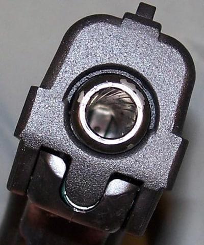 closeup of barrel of hi point handgun