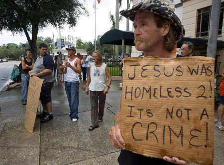 Religious Homeless with sign