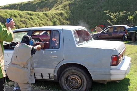 shooting guns through cars on tactical range