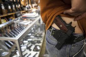 gun in holster of shopper at gun store