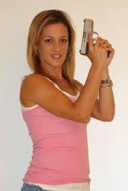 emily miller posing with gun