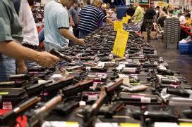 handguns displayed at gun show table