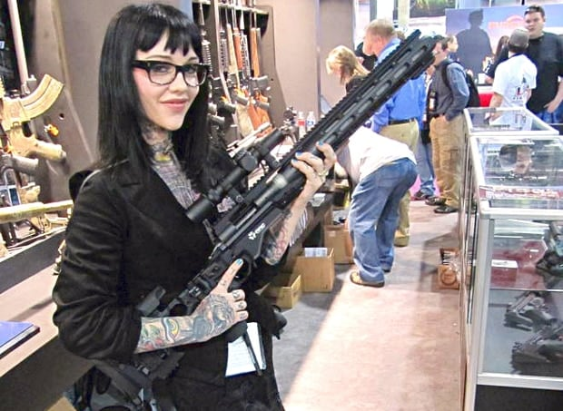 Woman with Remington Model 700 300 AAC Blackout 330 Blackout Bullets Sliencers