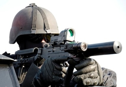 Soldier posing with UZI PRO and Meprolight reflex sight
