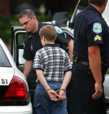Kid in Cuffs being arrested