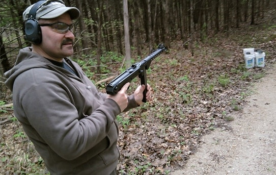 Man holding the Wise Lite KP-44 pistol.
