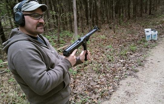 Man holding the Wise Lite KP-44 pistol.