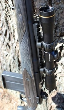 Leupold FX-II mounted to a Ruger Gunsite rifle and leaning against a tree.