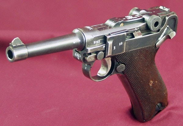 antique luger pistol on pink sheet