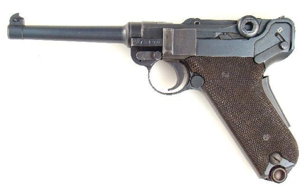 antique swiss luger pistol on white background
