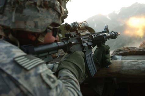 Soldier firing an M4 Carbine