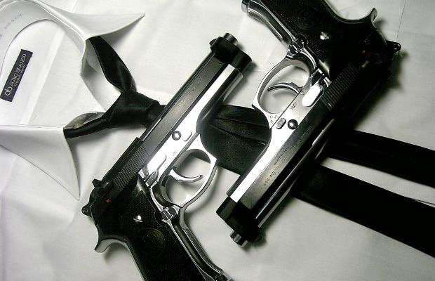 2 beretta 92fs pistols on a shirt and tie