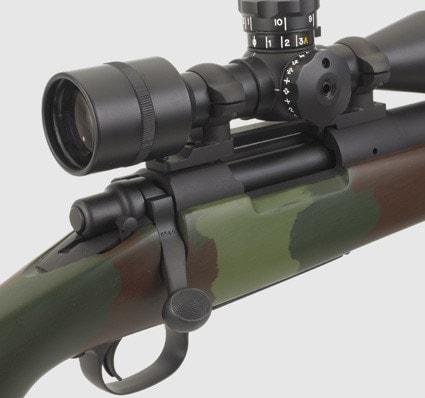 closeup shot of scope on sniper rifle