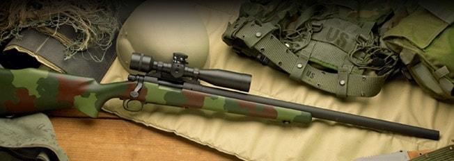 camoflauge sniper rifle on bag