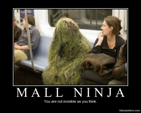 person with grass camo on subway train