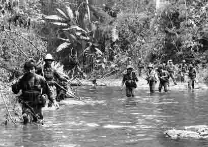 soldiers crossing stream