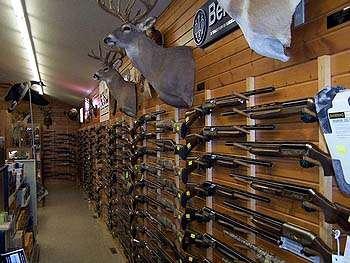 shotguns displayed in a gun store