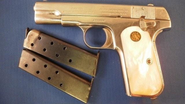 ivory handle handgun