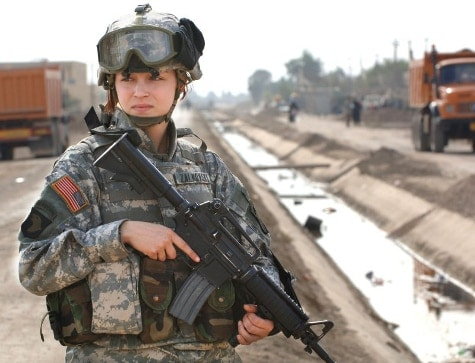female military member with M4A1