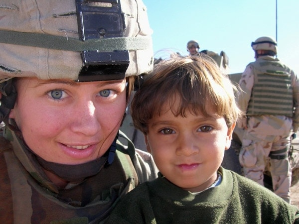 Airman Polly-Jan Bobseine with child