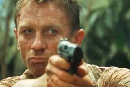 daniel craig as james bond shooting a walther handgun