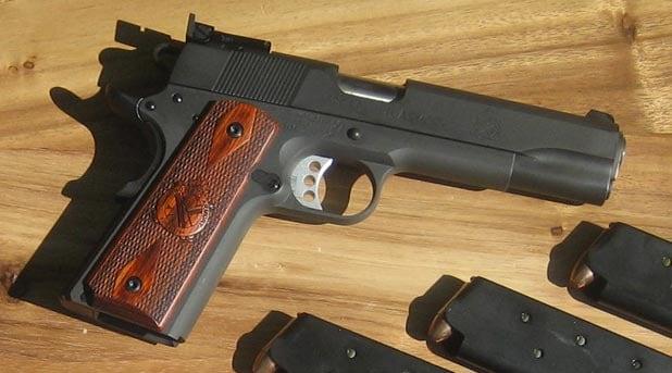 springfield armory range officer handgun on wooden table