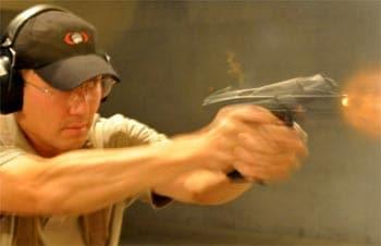 man wearing firearm ear protection at range