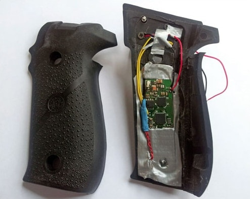 A TriggerSmart readerboard inserted in a SIG pistol grip panel