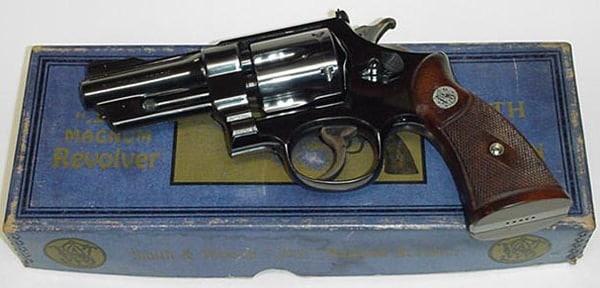 magnum revolver on top of antique box