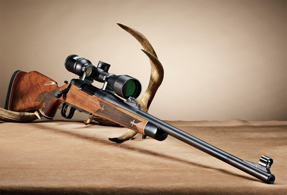 Remington 700 Anniversary Edition and a rack