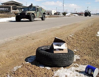 ied on side of road