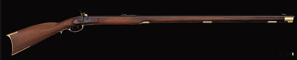 wooden musket on black background