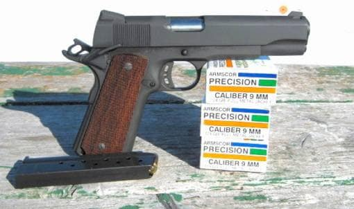 rock island armory 1911 on table with precision 9mm ammo boxes