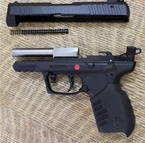 The Ruger SR22 pistol field stripped.