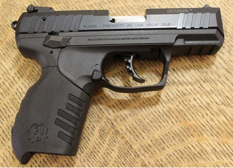 The Ruger SR22 Pistol sits on top of a table.