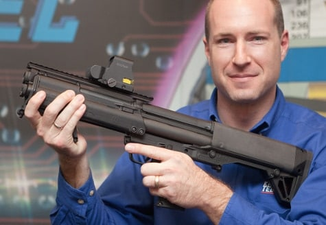 Mr. Kel Tec, with gleaming eyes and a handsome grin, shows off the KSG Shortie.