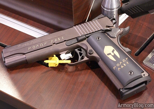 The SIG 1911 Spartan is displayed on a desk