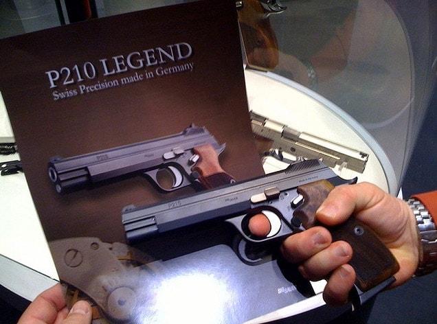 sig p210 legend handgun next to brochure