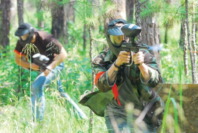 paint ballers in the forest