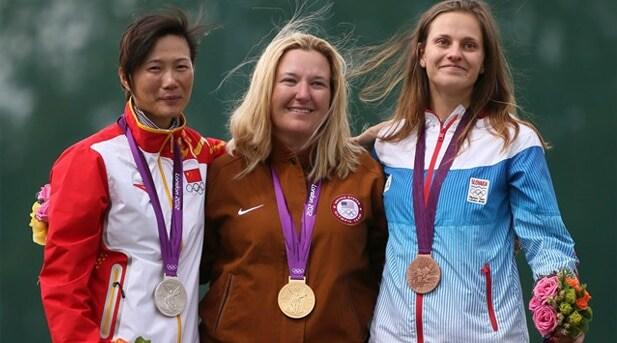 Silver medalist Ning Wie of China, gold medalist Kim Rhodes, and bronze medalist Danka Bartekova of Slovakia.