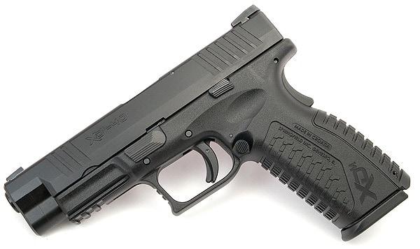 xdm handgun laying flat on white background