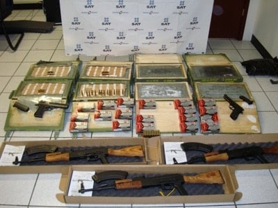 confiscated rifles handguns and ammos sitting in box