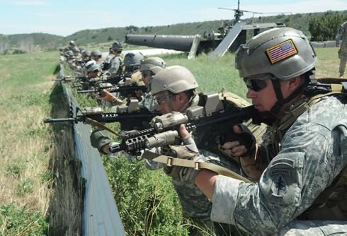 SOCOM forces stationed by helicopter
