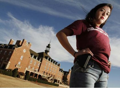college girl with gun in holster