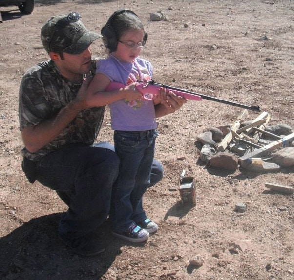 Father and daughter target shooting