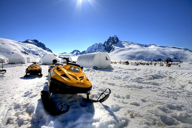 snowmobile parked on snowy mountain