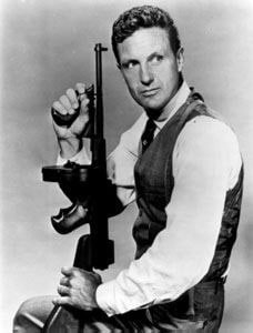 elliott ness holding a tommy gun