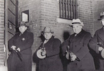 police holding tommy guns