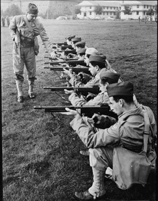 soldiers holding machine guns